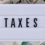 Issue 31-4 - Columnist Forum - Delano Sherley - Local Income Taxes