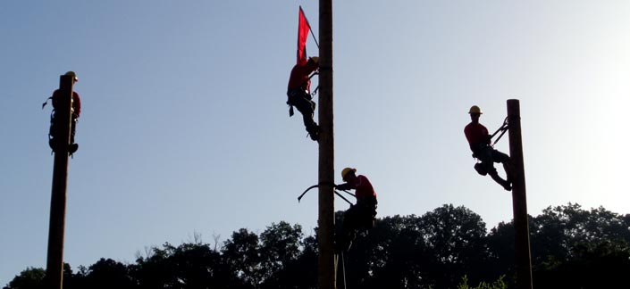 Electrical workers on poles