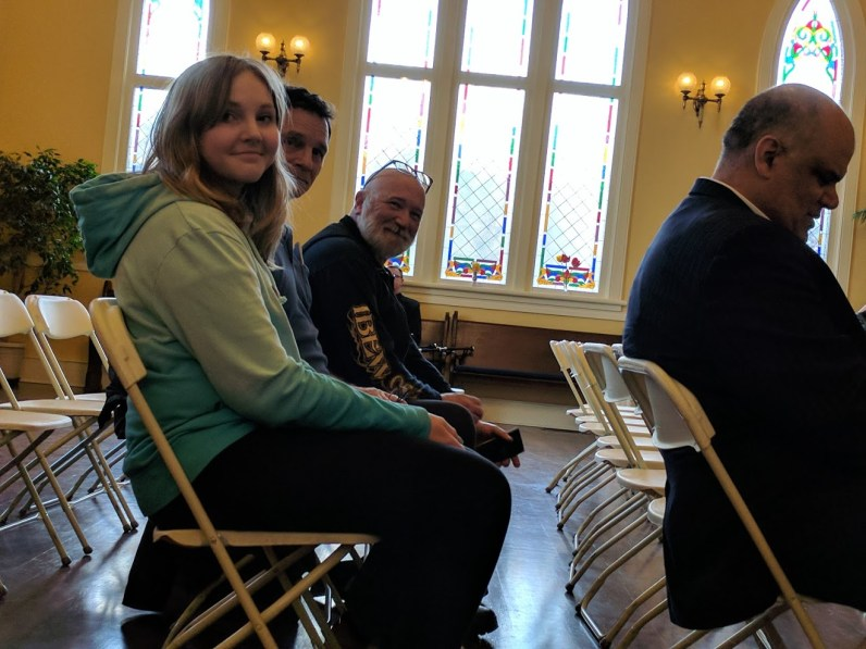 Kira Schmidt, Lyle Harpe, and Glen Hilton before the ceremony started. Acting Mayor Arjun Singh in front.