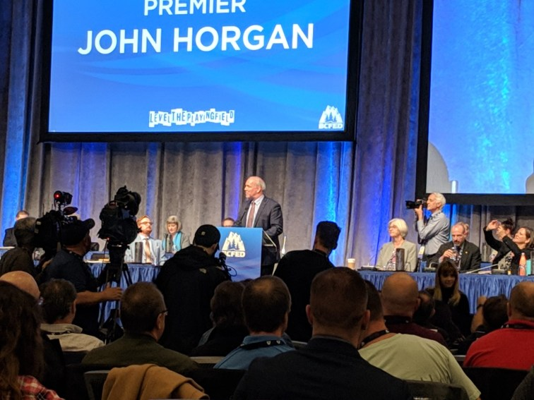 John Horgan on stage
