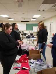 IBEW 993 Women's committee members Rebecca Scott, Inez Hegelstad, Shanna Harris, Tammy Schnieder assembling Comfort Cases