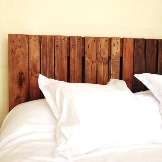 Cabecero de cama con madera de palet