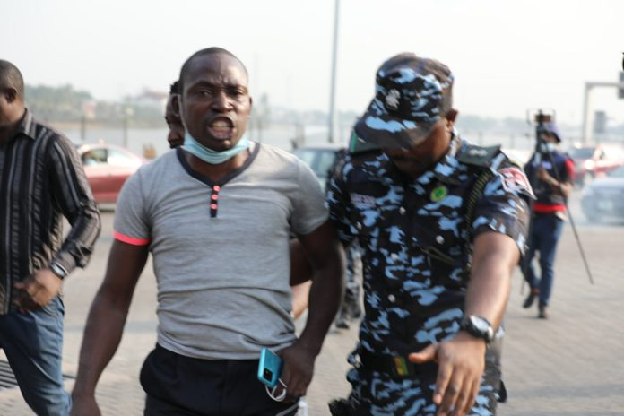 Photos: Tension as Police arrest protester Lekki tollgate