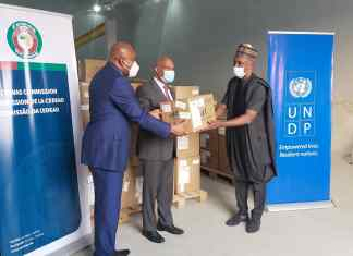From L-R: Prof. Stanley Okolo, Dg West African Health Organisation (WAHO), President of ECOWAS Jean-Claude Brou and Country Representative of UNDP Mohamed Yahya during the handover of 14 million dollars worth of COVID-19 kits in Abuja on Wednesday