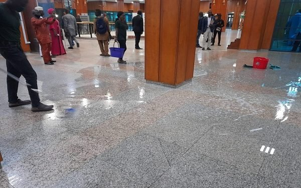 Cleaners Use Buckets To Collect Water As Nations Assembly Roof Leaks During Plenary