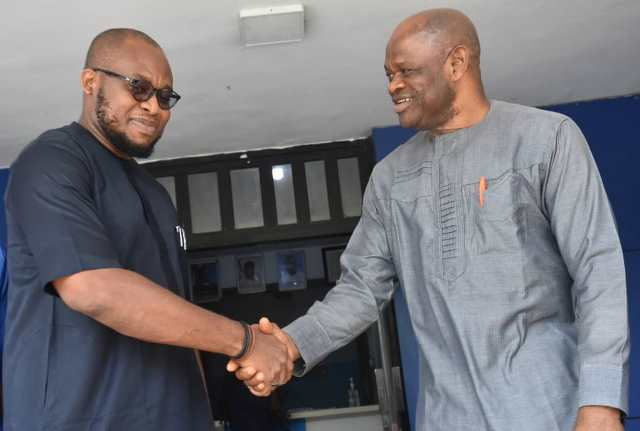 Mr Chijioke Uzoho, Commercial Manager, GACN and Mr Silas Nwoha in a handshake during the GACN visit to NAN headquarters, Abuja on Thursday
