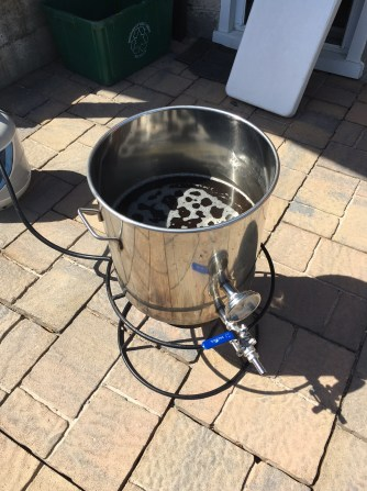 Heating the 4 gallons of mash cider