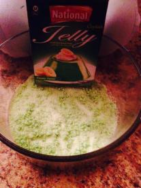 After 1st layer is set, add green powder jello jelly in bowl.