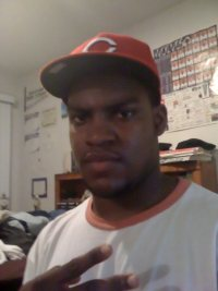 Photo of James Ecford, a large young African-American man. He's wearing a baseball cap and T-shirt.