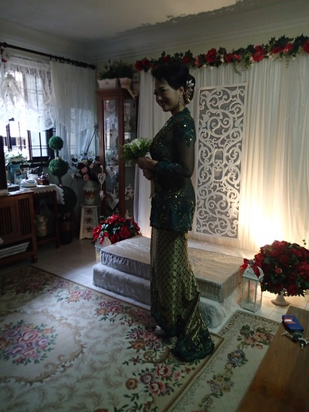 the lovely bride in her moss green baju