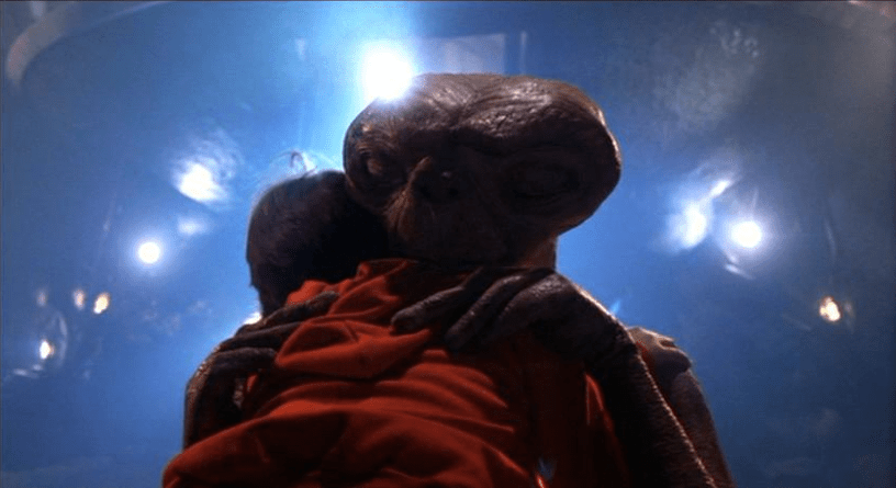 Elliott (Henry Thomas) hugs E.T. in the emotional finale of E.T. THE EXTRA-TERRESTRIAL (1982)