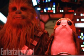 Chewbacca and a Porg in the cockpit of the Millennium Falcon in STAR WARS: THE LAST JEDI.