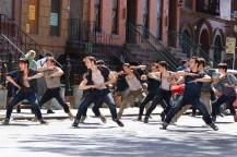 Members of the Jets dance on the streets of New York City in this on-set shot from Steven Spielberg's adaptation of WEST SIDE STORY (2020)