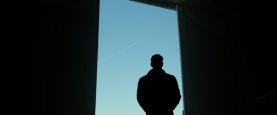 Maverick (Tom Cruise) stands in silhouette in TOP GUN: MAVERICK (2020)