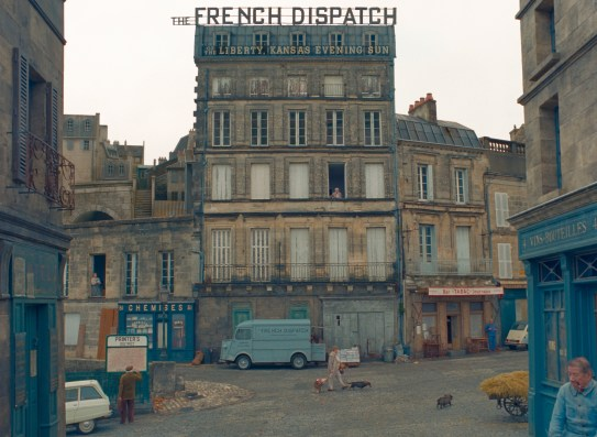 A street in a fictional 20th-century French city, in Wes Anderson's THE FRENCH DISPATCH (2020)