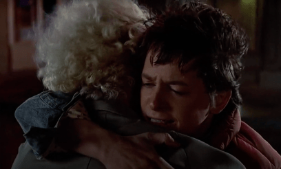 Marty McFly (Michael J. Fox) hugs Doc Brown at a crucial moment in BACK TO THE FUTURE (1985).