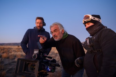 Director and co-writer Paul Greengrass (center) with crew members on the set of News of the World.