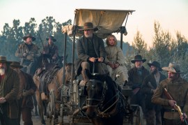 (from left, center) Captain Jefferson Kyle Kidd (Tom Hanks) and Johanna Leonberger (Helena Zengel) in News of the World, co-written and directed by Paul Greengrass.