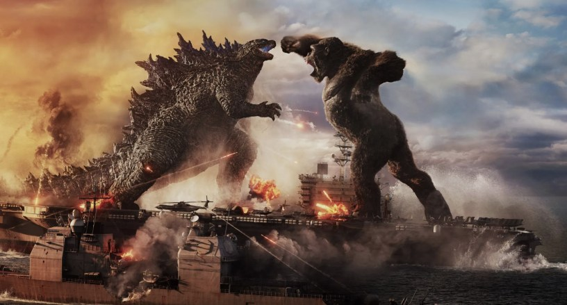 The titular monsters fight on the open sea in GODZILLA VS KONG (2021)