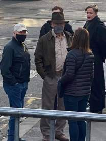 Harrison Ford (along with producers Frank Marshall and Lucasfilm President Kathleen Kennedy) on the U.K. set of INDIANA JONES 5 (2022)