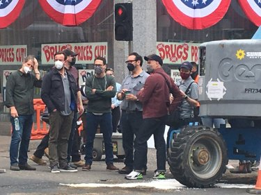 Director James Mangold (in gray shirt and black mask) on the Glasgow, Scotland set of INDY 5.