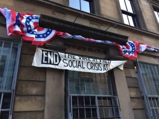 A Vietnam War protest banner in 1969 NYC, on the Glasgow set of INDY 5.