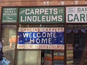 A welcome sign in 1969 NYC, decorated on a ticker tape parade route for the Apollo 11 crew in INDY 5.