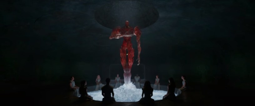 Eternals gather around a galactic being known as a Celestial in Marvel's ETERNALS (2021)