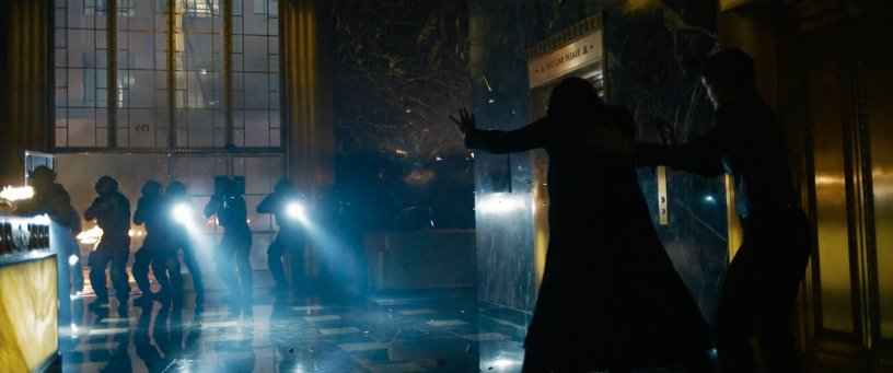 Neo (Keanu Reeves) and Trinity (Carrie-Anne Moss) attempt to escape a heavily-armed SWAT team in THE MATRIX RESURRECTIONS (2021)