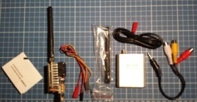 L to R: Users Manual, Transmitter, Power and Camera Cables, Rx Antenna, Receiver, Power Cable and AV Cables