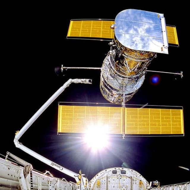 The Hubble Space Telescope is deployed on April 25, 1990 from the space shuttle Discovery. Avoiding distortions of the atmosphere, Hubble has an unobstructed view peering to planets, stars and galaxies, some more than 13.4 billion light years away.