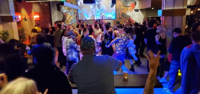 A group of PAX attendees are dancing the night away.