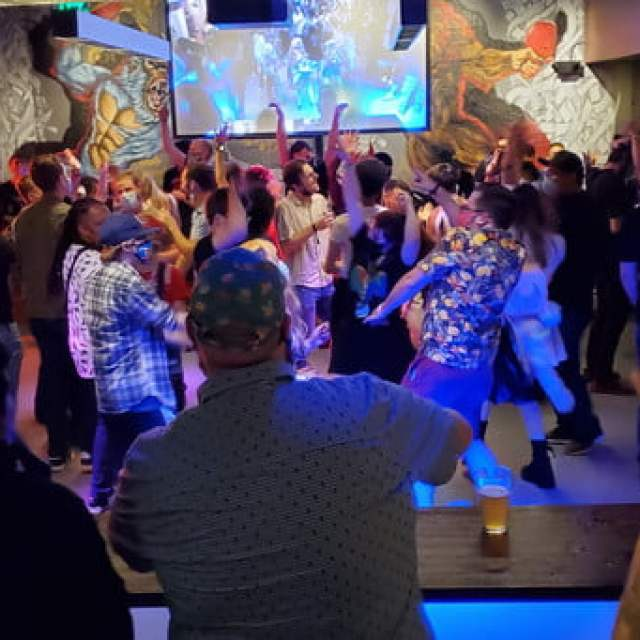 A group of PAX attendees, dancing the night away.