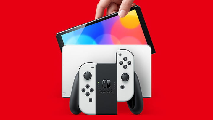 White Nintendo Switch OLED dock and Joy-Con in grip.