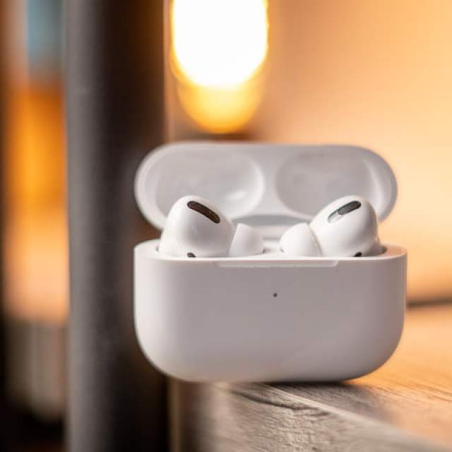 Apple AirPods in a charging case.