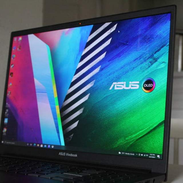 Asus Vivobook Pro 16X OLED sitting on a table top.