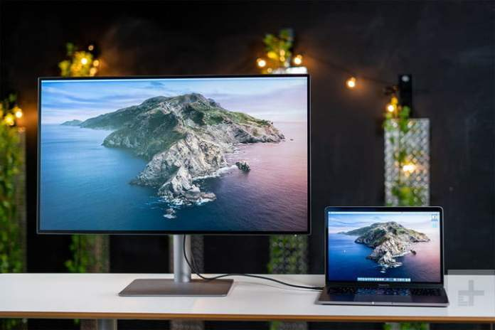 The BenQ PD3220U is sitting at a desk and connected to a laptop.
