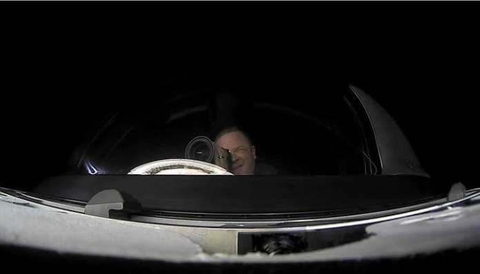 Chris Sambrowski taking a picture from the dome of Crew Dragon.