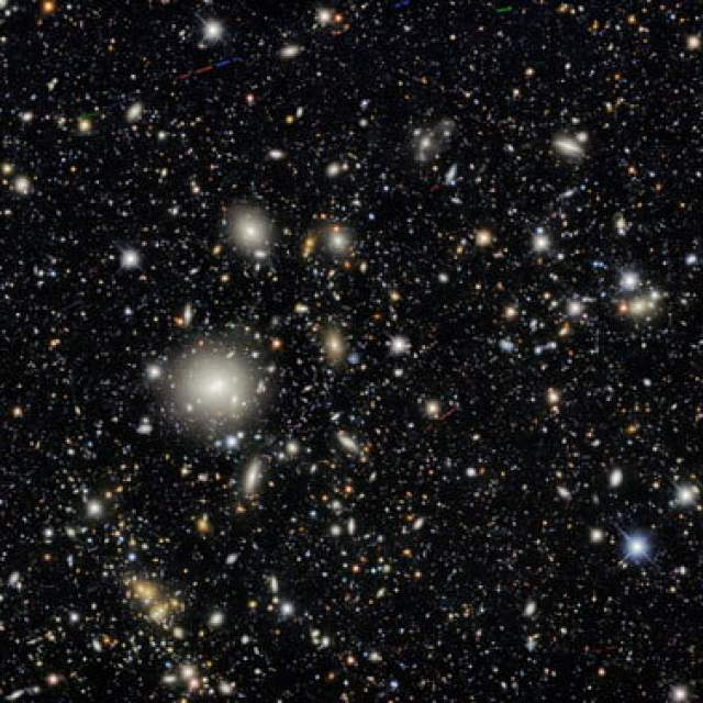 """Ten areas in the sky were selected as """"deep fields"""" that the Dark Energy Camera imaged several times during the survey, providing a glimpse of distant galaxies and helping determine their 3D distribution in the cosmos. The image is teeming with galaxies — in fact, nearly every single object in this image is a galaxy. Some exceptions include a couple of dozen asteroids as well as a few handfuls of foreground stars in our own Milky Way."""