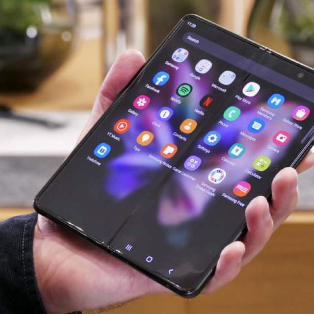 Open Galaxy Z Fold 3 with apps shown.