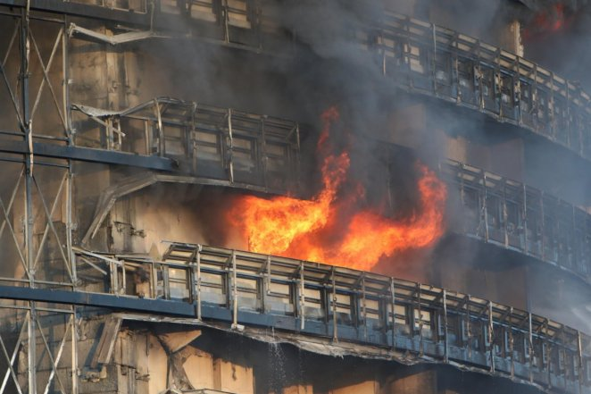 Fire in 15-storey building in Italy #9