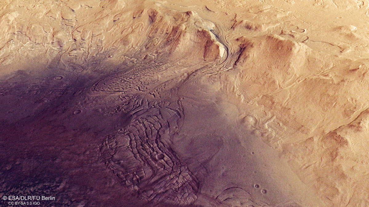 This image shows a feature on Mars' surface named Moreux crater. It comprises data gathered on 30 October 2019 during orbit 20014. The ground resolution is approximately 16 m/pixel and the images are centred at about 44°E/42°N.