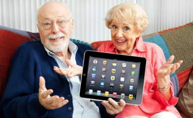 Photo of elderly couple proudly showing off their new iPad