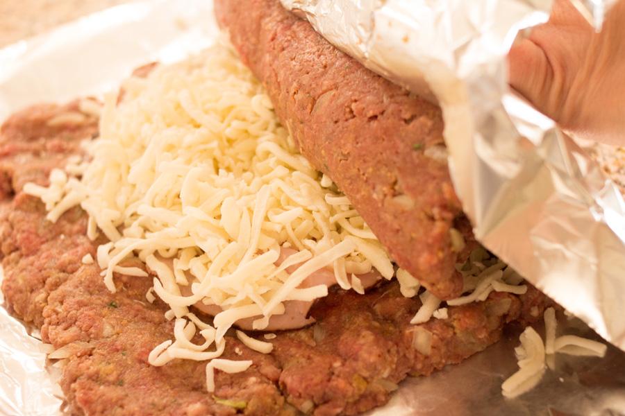 Sunday dinner just got awesome! Try this impressive stuffed meatloaf and you'll never make ordinary meatloaf again!