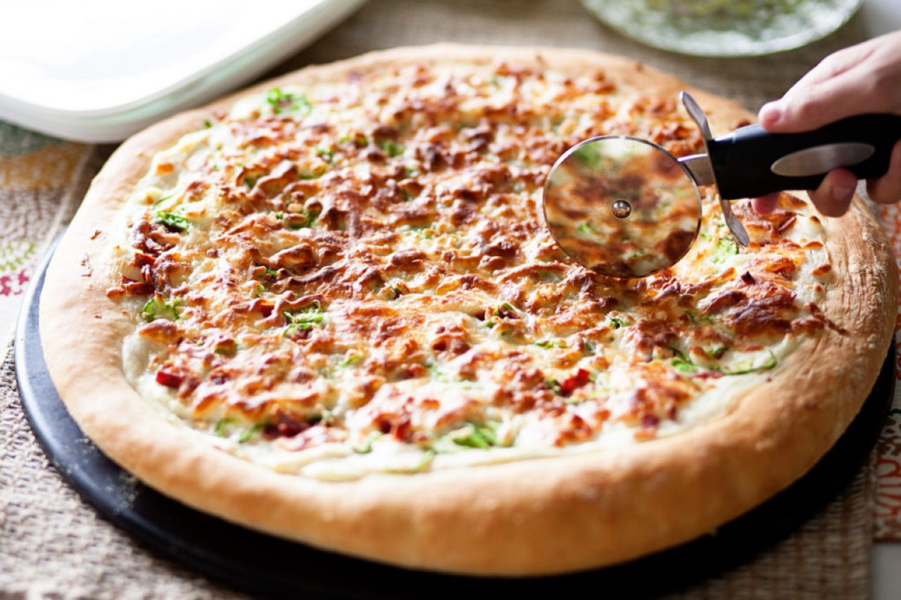 You can not get any better than this Jalapeno Popper pizza loaded with jalapenos, bacon, onions, and cheese! Perfect pizza dough, easy pizza recipe