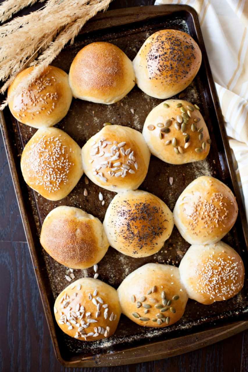 These Home Made Hamburger buns are super soft, but firm enough to support your burger and all the fixins! Sprinkle the tops with seeds to make them gourmet! Be the star of your next barbecue by bringing these fantastic buns!