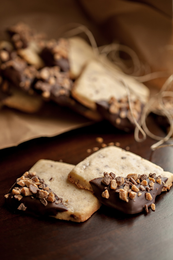 Buttery shortbread cookies with chopped pecans, dipped in chocolate and sprinkled with toffee bits. This recipe is adapted from Coffee Toffee Shortbread in Sally's Cookie Addiction.
