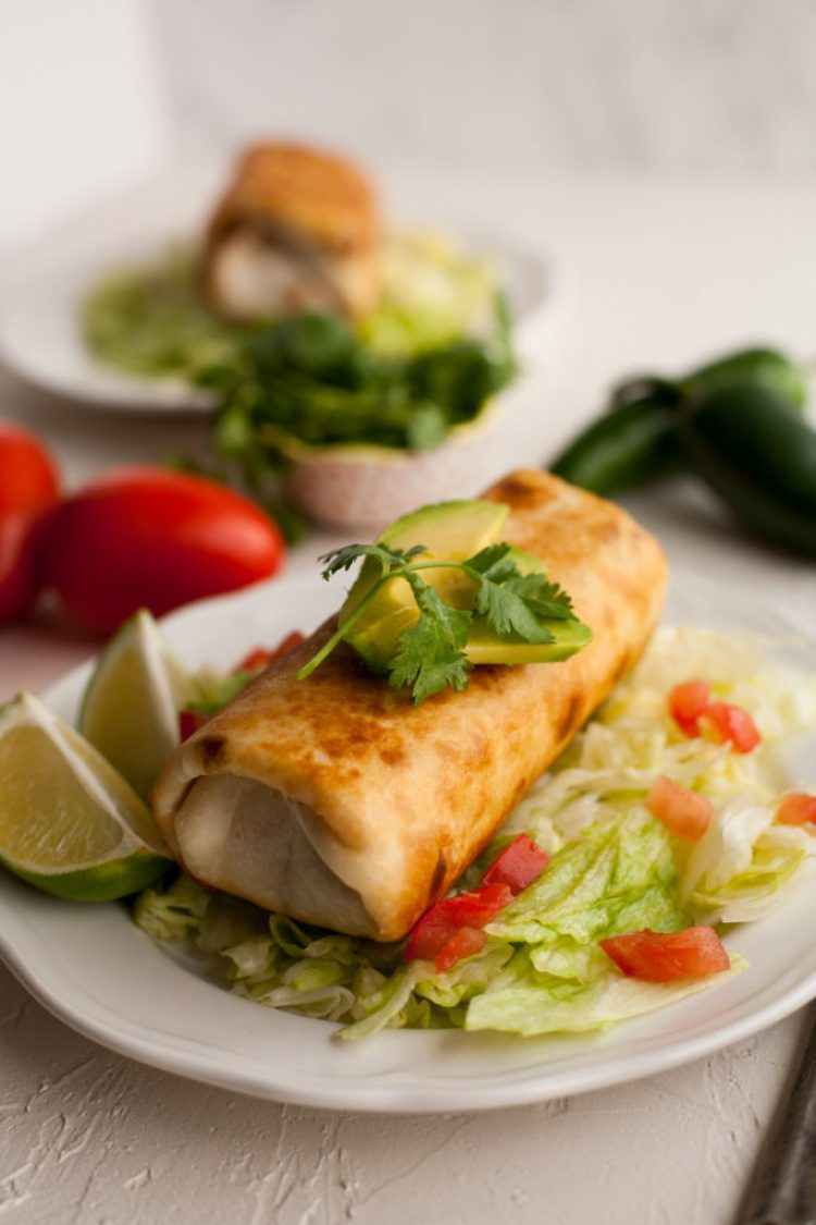 Crispy, golden Chimichangas made with chicken, pork, or beef! The perfect weeknight meal!