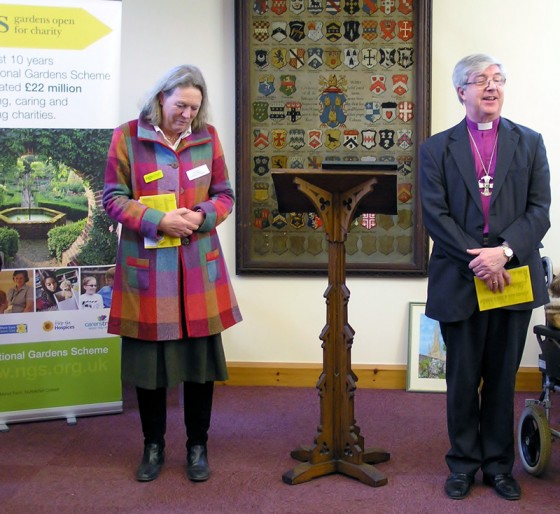 Fiona Black (County Organiser NGS),  Bishop of Norwich Rt Rev Graham Jenkins launching booklet at Bishop's House