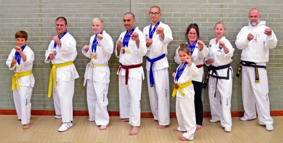 medal-winners-and-instructors-fighting-stance-oct-2015